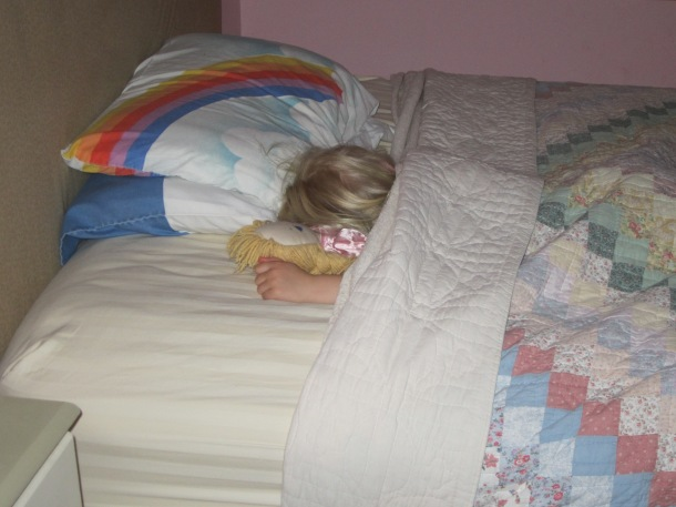 "Caroline dreaming away with a doll that her Granny gave her when she was ""little"""